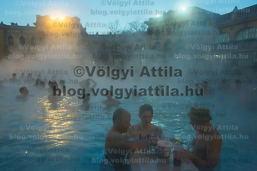 Visitors enjoy a 38 degree Celsius heat of the water in the -2 degree Celsius cold winter in the open air pool of Szechenyi Thermal Bath in Budapest, Hungary on January 11, 2017. ATTILA VOLGYI