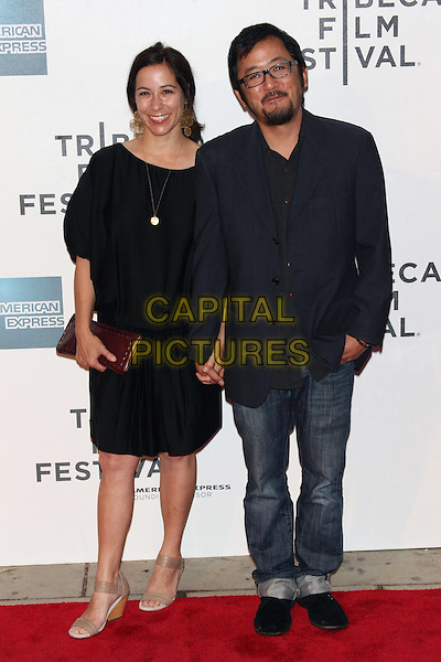 "DENNIS LEE (R) (Director) & wife .attending the 10th Anniversary Edition of the Tribeca Film Festival - Premiere of ""Jesus Henry Christ"" at the Tribeca Performing Arts Center, New York, NY, USA, April 23rd, 2011..full length glasses black shirt jacket beard goatee facial hair  jeans holding hands dress jacket .CAP/LNC.©TOM/LNC/Capital Pictures."