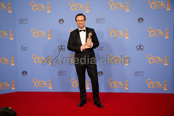 """After winning the category of BEST PERFORMANCE BY AN ACTOR IN A SUPPORTING ROLE IN A SERIES, MINI-SERIES OR MOTION PICTURE MADE FOR TELEVISION for his role in """"Mr. Robot,"""" actor Christian Slater poses backstage in the press room with his Golden Globe Award at the 73rd Annual Golden Globe Awards at the Beverly Hilton in Beverly Hills, CA on Sunday, January 10, 2016. Photo Credit: HFPA/AdMedia"""