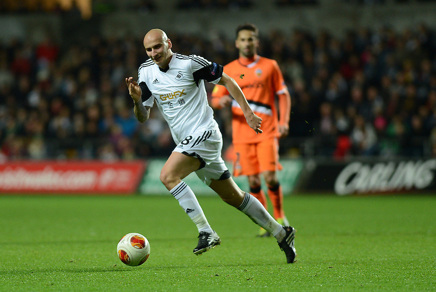 Swansea City's Jonjo Shelvey in action during todays match  <br /> <br /> Photo by Ian Cook/CameraSport<br /> <br /> Football - UEFA Europa League Group A - Swansea City v Valencia - Thursday 28th November 2013 - The Liberty Stadium - Swansea<br /> <br /> &copy; CameraSport - 43 Linden Ave. Countesthorpe. Leicester. England. LE8 5PG - Tel: +44 (0) 116 277 4147 - admin@camerasport.com - www.camerasport.com