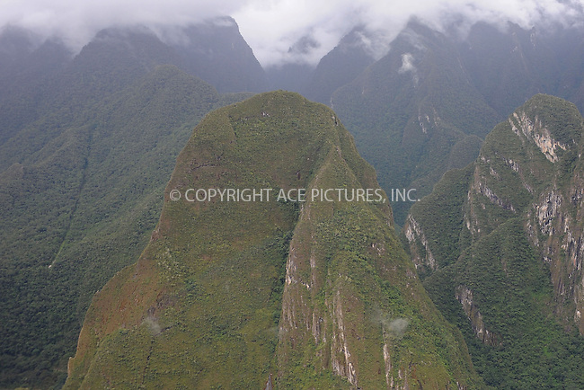 WWW.ACEPIXS.COM . . . . . .January 8, 2013...Peru...Putucusi, Quechua for ?Happy Mountain?, is a round-shaped mountain located on the Urubamba River on January 8, 2013 in Peru ....Please byline: KRISTIN CALLAHAN - ACEPIXS.COM.. . . . . . ..Ace Pictures, Inc: ..tel: (212) 243 8787 or 212 489 0521..e-mail: kristincallahan@aol.com...web: http://www.acepixs.com .