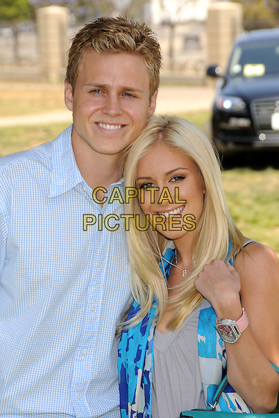 "SPENCER PRATT & HEIDI MONTAG .""A Time For Heroes"" Celebrity Carnival Benefit for the Elizabeth Glaser Pediatric AIDS Foundation at the Wadsworth Fairgrounds, Los Angeles, California, USA..June 8th, 2008.half length blue shirt couple pink watch .CAP/ADM/BP.©Byron Purvis/AdMedia/Capital Pictures."