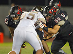 Lawndale, CA 11/11/16 - Damian Gutierrez (Lawndale #63), Matthew Driesler (West Torrance #65) and Angel Becerra (Lawndale #56) in action during the West Torrance - Lawndale CIF first round playoffs.  Lawndale defeated West Torrance 48-14.