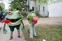 Frog representing creatures of water waiting for mate to make cell call. MayDay Parade and Festival. Minneapolis Minnesota USA