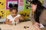 Preschool  intake assessment woman with child performing developmental tasks