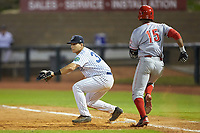 Mickey Gasper (33) of the Pulaski Yankees waits for the throw as Jonathan Willems (15) of the Greeneville Reds hustles towards first base at Calfee Park on June 23, 2018 in Pulaski, Virginia. The Reds defeated the Yankees 6-5.  (Brian Westerholt/Four Seam Images)
