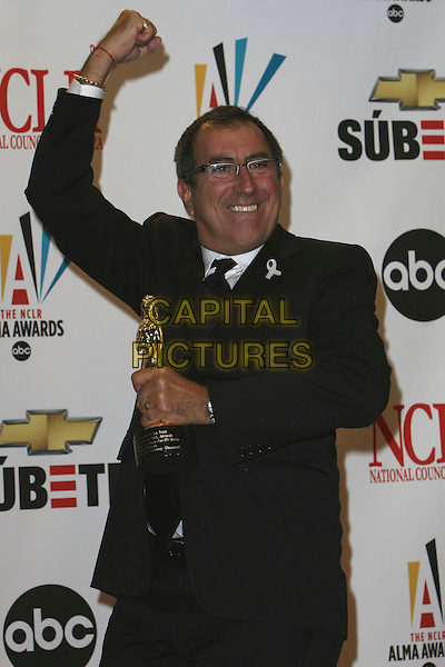 KENNY ORTEGA .2007 NCLR ALMA Awards - Press Room held at the Pasadena Civic Center, Pasadena, California, USA..June 1st, 2007.half length black award trophy glasses suit jacket arm in air.CAP/ADM/CH.©Charles Harris/AdMedia/Capital Pictures *** Local Caption *** .