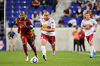 Joel Lindpere (20) of the New York Red Bulls is chased by Andy Williams (77) of Real Salt Lake. Real Salt Lake defeated the New York Red Bulls 3-1 during a Major League Soccer (MLS) match at Red Bull Arena in Harrison, NJ, on September 21, 2011.