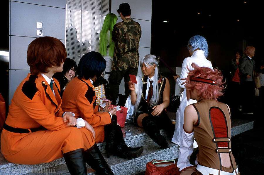 Friends gather around during a break at a cosplay even in Tokyo.  Such events attract hundreds of manga fans and are an important element of the manga culture.