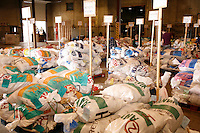 An army of Volunteers work in a warehouse to move, sort, weigh, and stack the mushers tens of thousands of pounds of food and gear for the 22 checkpoints.   Iditarod 2009