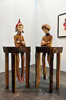 HONG KONG - MARCH 13: Sculptures 'Desk Boy - Sun' (left) and 'Desk Boy - Moon' (right) by Koji Tanada are on display in art fair Art Basel on its preview day on March 13, 2015 in Hong Kong, Hong Kong.  (Photo by Lucas Schifres/Getty Images)