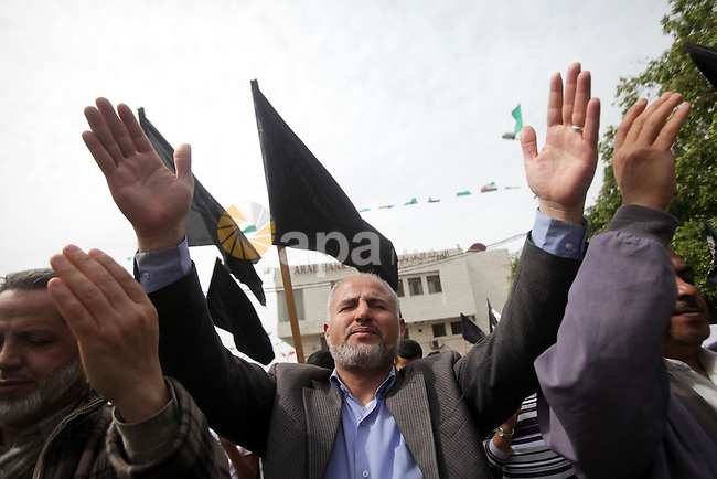 Members of Hizb ut-Tahrir hold placards during a protest following Friday prayers in support of the Syrian people, in Gaza city on March 15, 2013. Photo by Yasser Qudeh