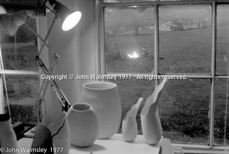 Liz Fritsch, potter, lived and worked at Digswell House, an artists' community run by the Digswell Arts Trust, Welwyn Garden City, Hertfordshire, UK.  1977.  View from Liz's window onto the lawn. Other artists there at the time included: Lol Coxhill, jazz saxophonist, Veryan Weston, jazz pianist, John Blakeley, sculptor, Patricia Leighton, sculptor and John Walmsley, photographer.