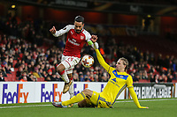 Theo Walcott of Arsenal is tackled by Maksim VOLODKO of FC BATE Borisov during the UEFA Europa League match between Arsenal and FC BATE Borisov  at the Emirates Stadium, London, England on 7 December 2017. Photo by David Horn.