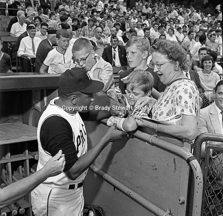 Pittsburgh PA:  Willie Stargell signing autographs at the HYPO charity baseball game with the Cleveland Indians - 1964.<br /> The money raised by HYPO (Help Young Players Organize) was used to help local communities buy equipment and build ball fields.