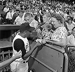Pittsburgh PA:  Willie Stargell signing autographs at the HYPO charity baseball game with the Cleveland Indians - 1964.<br />