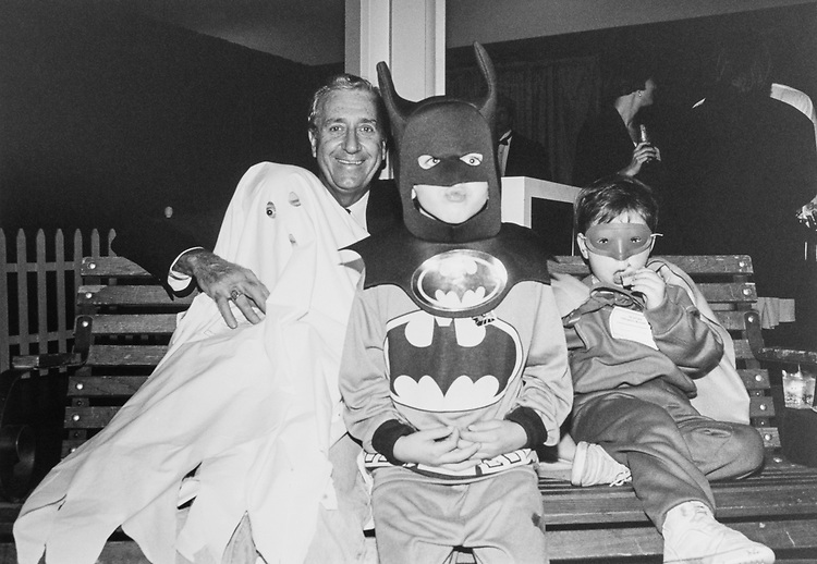 Rep. William J. Hughes, D-N.J. with his grandsons Barry (age 7) as a ghost, Brendon (age 6) as Batman, and Bryan (age 4) as Robin during Halloween party on Oct. 28, 1993. (Photo by Laura Patterson/CQ Roll Call)