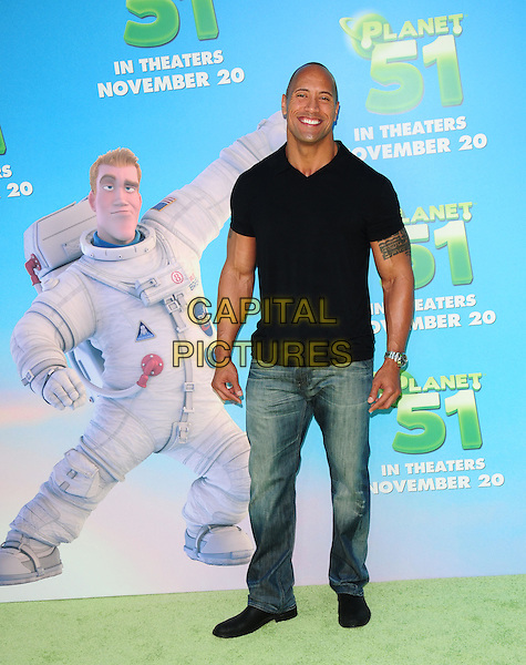 "DWAYNE 'THE ROCK"" JOHNSON .arriving at the Columbia Pictures' L.A. Premiere of  ""Planet 51"" at Mann Village Theatre in Westwood, California, USA, .November 14th, 2009..full length black t-shirt collar jeans tattoo.CAP/RKE/DVS.©DVS/RockinExposures/Capital Pictures"