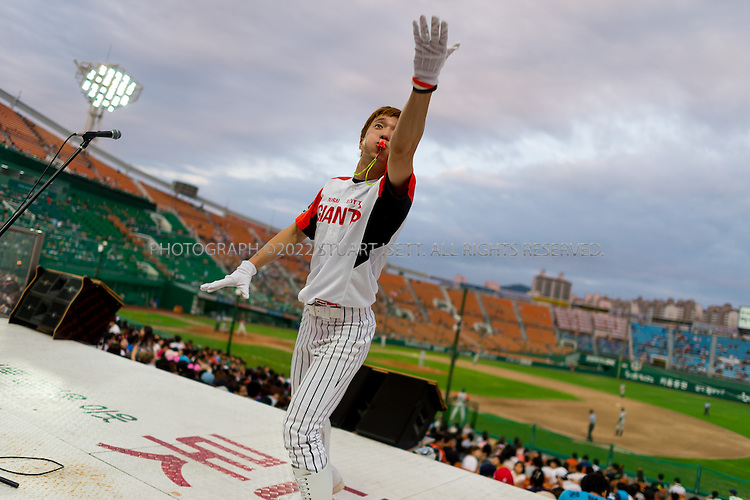 9/1/2013--Busan, South Korea<br /> <br /> Fans and supporters are encouraged bya  cheerleader at a Lotte Giants baseball game at Sajik stadium in Busan (Pusan), South Korea.<br /> <br /> Photograph by Stuart Isett