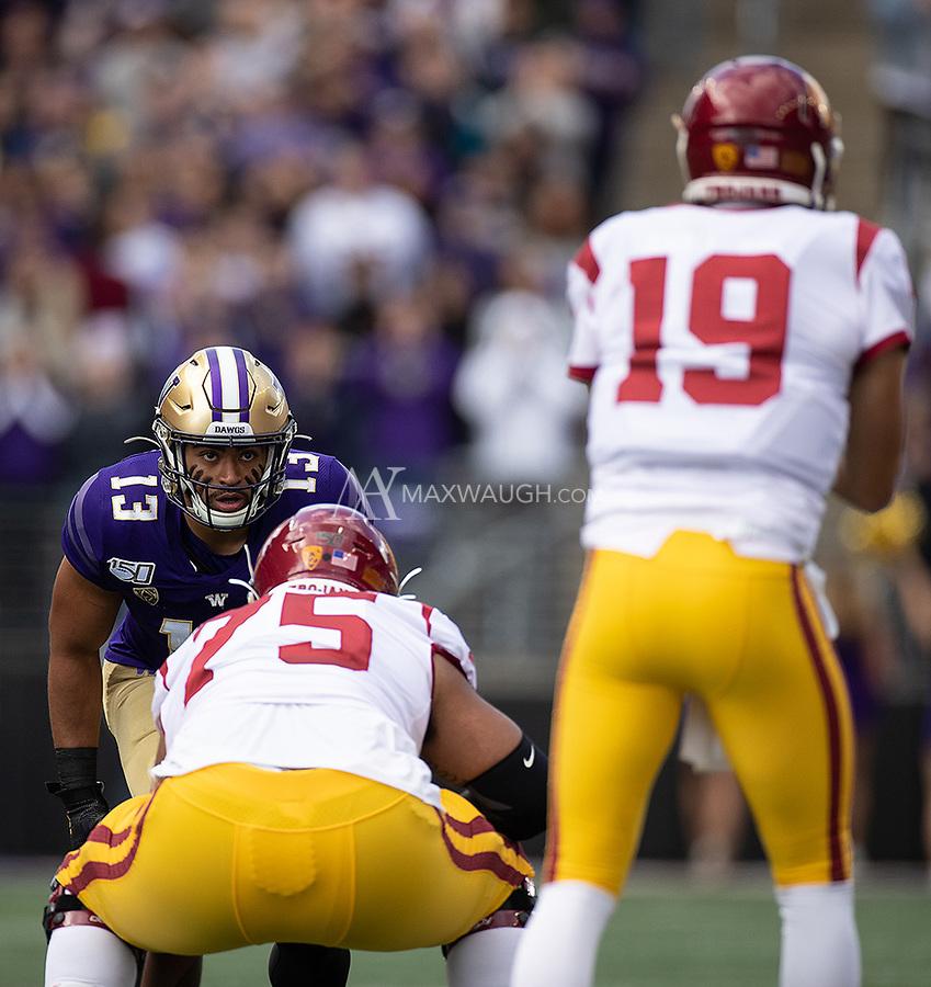 Brandon Wellington eyes the USC quarterback.
