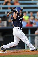 Asheville Tourists left fielder Corey Dickerson #23 swings at a pitch during a game against the Rome Braves at McCormick Field on August 20, 2011 in Asheville, North Carolina. Rome won the game 10-9.   (Tony Farlow/Four Seam Images)