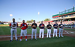 The competitors in the Triple-A All Star Home Run Derby listen to the National Anthem in Reno, Nev., on Monday, July 15, 2013. <br /> Photo by Cathleen Allison