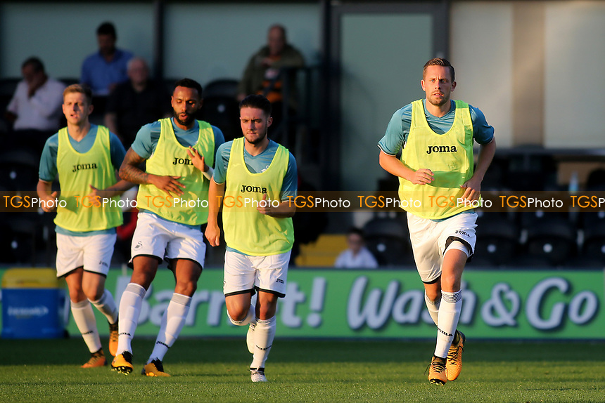 Swansea's Gylfi Sigurdsson (far right) warms up at half-time in readiness to play the second half during Barnet vs Swansea City, Friendly Match Football at the Hive Stadium on 12th July 2017