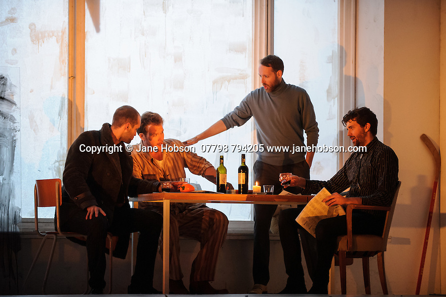 London, UK. 14.10.2015. English National Opera presents, in a co-production with Dutch National Opera, Amsterdam, Puccini's LA BOHEME, at the London Coliseum. Picture shows: Ashley Riches (Schaunard), Duncan Rock (Marcello), Nicholas Masters (Colline), Zach Borichevsky (Rodolfo).  Photograph © Jane Hobson.