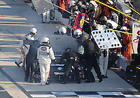 May 30, 2008; Dover, DE, USA; Nascar Craftsman Truck Series driver Kyle Busch sits on pit road as crew members look under the hood after blowing a transmission during the AAA Insurance 200 at Dover International Speedway. Mandatory Credit: Mark J. Rebilas-US PRESSWIRE.