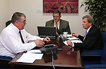 From left, Nevada Sen. Pete Goicoechea, R-Eureka, Assemblyman James Oscarson, R-Pahrump, and Assemblyman John Ellison, R-Elko, work on a conference call at the Legislative Building, in Carson City, Nev., on Friday, April 26, 2013. A number of Republican state lawmakers are renewing their opposition to an effort by some Senate Republicans to add a 10 percent tax on Nevada's gold and silver mine operators. (AP Photo/Cathleen Allison)