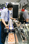 An exhibitor gives a demonstration during the International Food Machinery & Technology Exhibition ''FOOMA JAPAN'' 2016 in Tokyo Big Sight on June 7, 2016, Tokyo, Japan. FOOMA JAPAN showcases the latest products and services for food processing in 6 halls of the exhibition center. The show is organised by the collaboration of 53 food related industry organisations and runs from June 7 to 10. (Photo by Rodrigo Reyes Marin/AFLO)
