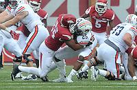 NWA Democrat-Gazette/MICHAEL WOODS • @NWAMICHAELW<br /> University of Arkansas defender Jeremiah Ledbetter tackles Auburn running back Peyton Barber in the second quarter of Saturdays game October, 24, 2015 against Auburn at Razorback Stadium in Fayetteville.