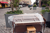 New York, NY -  22 June 2010- A piano in Gansvoort Plaza in the Meat Packing District of Manhattan awaits a pianist... <br /> <br /> &quot;Play Me I'm Yours&quot; is a musical installation by British artist Luke Jerram who has been touring the project globally since 2008. From 9am-10pm each day, 60 pianos will be available to play across New York City. Presented by Sing for Hope they are located in public parks, streets and plazas the pianos will be available until 5th July for any member of the public to play and engage with.