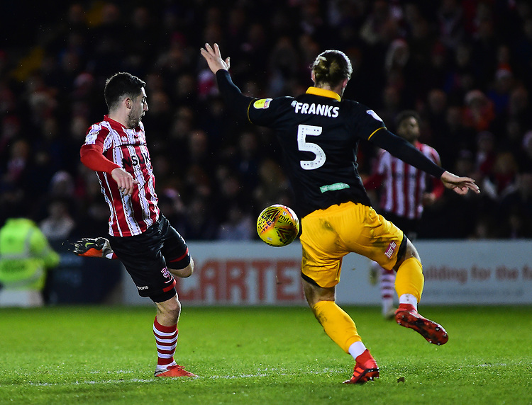 Lincoln City's Tom Pett scores his side's third goal<br /> <br /> Photographer Andrew Vaughan/CameraSport<br /> <br /> The EFL Sky Bet League Two - Lincoln City v Newport County - Saturday 22nd December 201 - Sincil Bank - Lincoln<br /> <br /> World Copyright © 2018 CameraSport. All rights reserved. 43 Linden Ave. Countesthorpe. Leicester. England. LE8 5PG - Tel: +44 (0) 116 277 4147 - admin@camerasport.com - www.camerasport.com