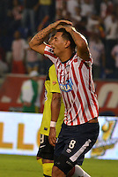 BARRANQUIILLA -COLOMBIA-01-09-2013. Edwin Cardona (D) del Junior se lamenta durante partido contra Nacional válido por la fecha 8 de la Liga Postobón II 2013 jugado en el estadio Metropolitano de la ciudad de Barranquilla./ Junior player Edwin Cardona (R) laments during match against Nacional valid for the 8th date of the Postobon League II 2013 played at Metropolitano stadium in Barranquilla city.  Photo: VizzorImage/Alfonso Cervantes/STR