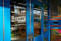 Sign painted on glass doors to the Granville Island Public Market, Vancouver, British Columbia, Canada
