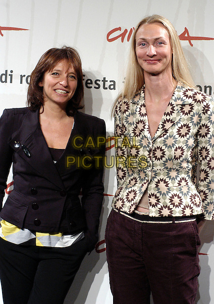 "SUSANNE BIER & SISSE GRAUM OLSEN.Photocall for ""After The Wedding"" at the Rome Film Festival, Rome, Itlay..October 19th, 2006.Ref: CAV.half length black jacket print white grey gray purple .www.capitalpictures.com.sales@capitalpictures.com.©Luca Cavallari/Capital Pictures."