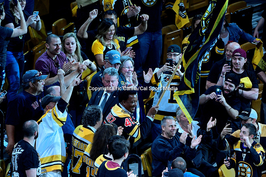 May 2, 2018: Retired Red Sox pitcher Pedro Martínez waves a Bruins flag before game three of the second round of the National Hockey League's Eastern Conference Stanley Cup playoffs between the Tampa Bay Lightning and the Boston Bruins held at TD Garden, in Boston, Mass. Tampa Bay defeats Boston 4-1. Eric Canha/CSM