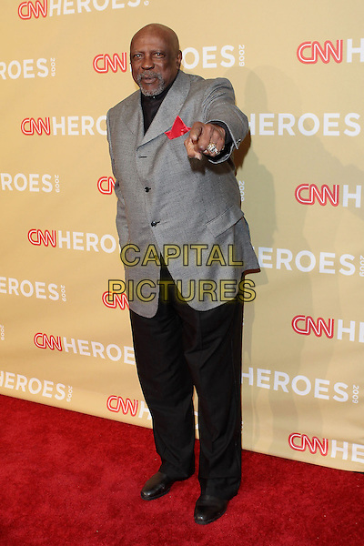 LOUIS GOSSETT JR..CNN Heroes: An All Star Tribute 2009  held at Kodak Theatre, Hollywood, California, USA..November 21st 2009 .full length black trousers grey gray suit jacket hand pointing arm .CAP/ADM/TC.©T. Conrad/AdMedia/Capital Pictures.