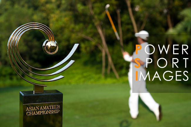SHENZHEN, CHINA - OCTOBER 29:  Asian Amateur Championship's trophy is displayed on the first hole while Peter Spearman-Burn of New Zealand watches his tee shot during the day one at the Mission Hills Golf Club on October 29, 2009 in Shenzhen, Guangdong, China.  (Photo by Victor Fraile/The Power of Sport Images) *** Local Caption *** Peter Spearman-Burn