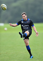 Darren Allinson of Bath Rugby puts boot to ball. Bath Rugby pre-season training session on July 28, 2017 at Farleigh House in Bath, England. Photo by: Patrick Khachfe / Onside Images