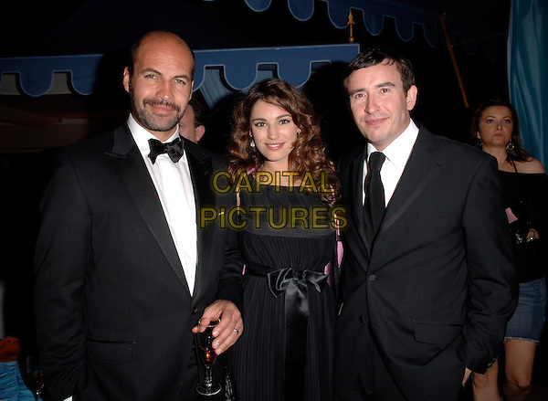 """BILLY ZANE, KELLY BROOK & STEVE COOGAN.""""Marie Antoinette"""" afterparty at the 59th International Cannes Film Festival, France. .May 24th, 2006.Ref: FIN.half length black suit tuxedo dress couple.www.capitalpictures.com.sales@capitalpictures.com.© Capital Pictures."""