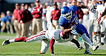 Freshman cornerback Zach Severance is tackled by an EKU player during the Cat's game against the Colonels on Saturday, Nov. 7, 2009 at Commonwealth Stadium. The Cats defeated the Colonels 37-12. Photo by Allie Garza | Staff