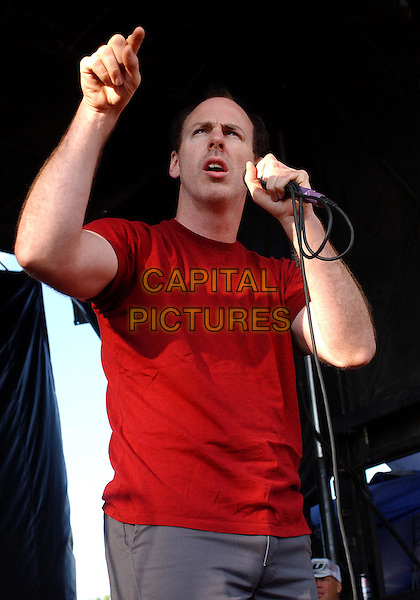 GREG GRAFFIN  OF BAD RELIGION.Performs during a tour stop of the '10th Anniversary Vans Warped Tour 2004' held at the Post-Gazette Pavilion, Pittsburgh, PA, USA, August 5, 2004..half length on stage gig music live concert pointing arm gesture red t shirt.Ref: ADM.www.capitalpictures.com.sales@capitalpictures.com.©JN/AdMedia/Capital Pictures .