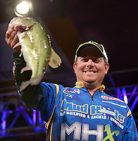 NWA Democrat-Gazette/BEN GOFF -- 04/25/15 John Cox, FLW pro from Debary, Fla., weighs-in on day three of the Walmart FLW Tour at Beaver Lake on Saturday Apr. 25, 2015 at the John Q. Hammons Center in Rogers. Cox stood in fourth place with a three-day total of 37 lbs.