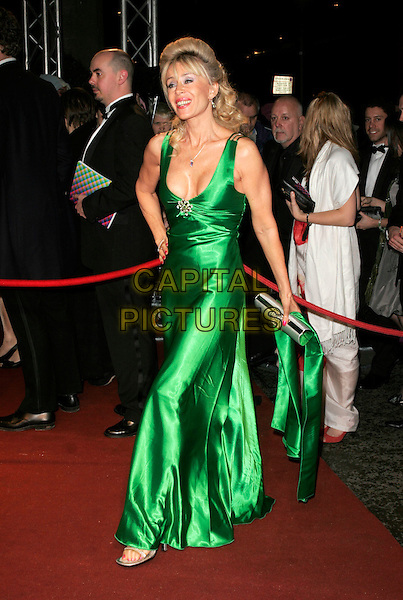 SALLY FARMILOE.The British Academy Television Awards 2008 after party held at the Grosvenor House Hotel,London, England..April 20th, 2008 .BAFTA BAFTA's full length green dress Farmilow cleavage silver clutch bag purse .CAP/AH.©Adam Houghton/Capital Pictures.