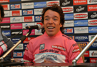 ITALIA. 22-05-2014. El nueva malla rosa Rigoberto Uran -Col- (Omega Pharma Quick-Step) en conferencia de prensa tras su victoria en la etapa 12 a cronómetro individual entre  Barbaresco y Barolo con una distancia de 42,2 Km en la versión 97 del Giro de Italia hoy 22 de mayo de 2014. / The new pink jersy Rigoberto Uran -Col- (Omega Pharma Quick-Step) in press conference after his victory on the 12th stage, single stopwatch, between Barbaresco and Barolo with a distance of 42.2 km in the 97th version of Giro d'Italia today May 22th 2014.   Photo: VizzorImage/ Gian Mattia D'Alberto / LaPresse<br /> VizzorImage PROVIDES THE ACCESS TO THIS PHOTOGRAPH ONLY AS A PRESS AND EDITORIAL SERVICE AND NOT IS THE OWNER OF COPYRIGHT; ANOTHER USE HAVE ADDITIONAL PERMITS AND IS  REPONSABILITY OF THE END USER