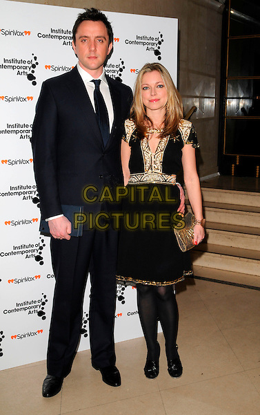 """PETER SERAFINOWICZ & SARAH ALEXANDER.The """"Figures of Speech"""" fundraising gala, Royal Horticultural Halls, London, England..February 27th, 2008.full length black suit dress gold cream trim clutch bag purse couple .CAP/CAN.©Can Nguyen/Capital Pictures."""