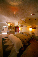 Goreme, Cappadocia, Turkey, July 2005. The bedroom stays cool in summer and warm in winter. Dutch Photographer Frits Meyst and his wife Jillian Macdonald restored an old rock house in the village of Goreme. Since Roman Times people have been cutting graves and home out of the Soft tufo 'Fairy Chmney' rocks of Cappadocia. Photo by Frits Meyst / MeystPhoto.com
