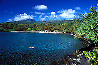 Snorkelers enjoy clear water at Hamoa Beach,Hana, Maui.